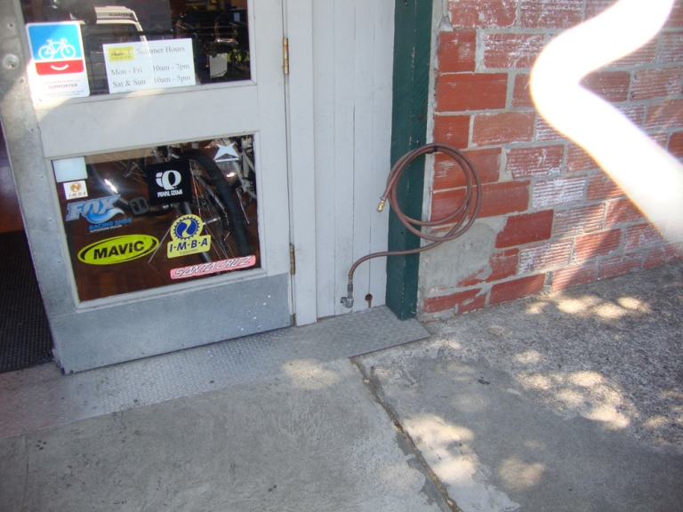 Hose by the door at Paul's Bicycle Way of Life (the Fifth Avenue location)