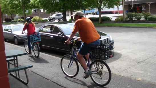 A couple riding two millk crate bikes
