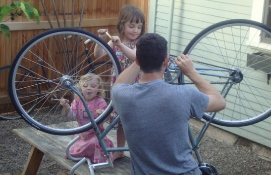Kids help build up a fixie
