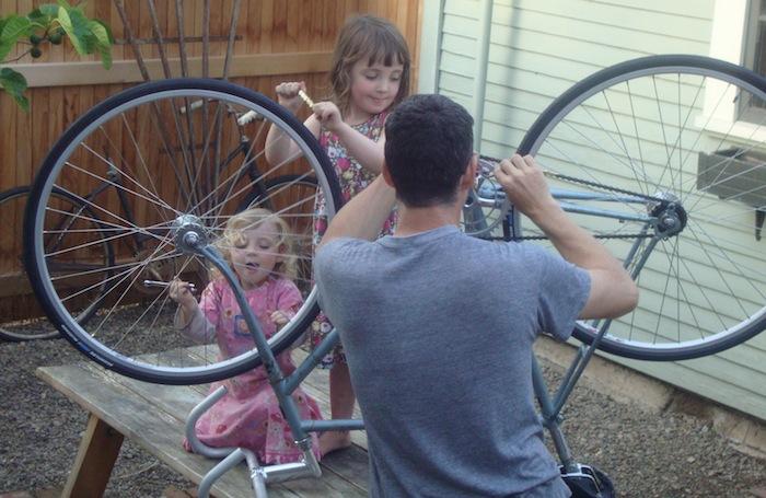 Kids help build up a fixie