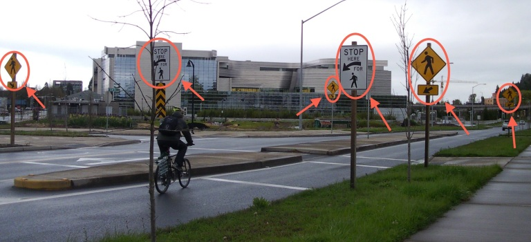 Heavily signed pedestrian crossing by the new Morse federal courthouse in Eugene