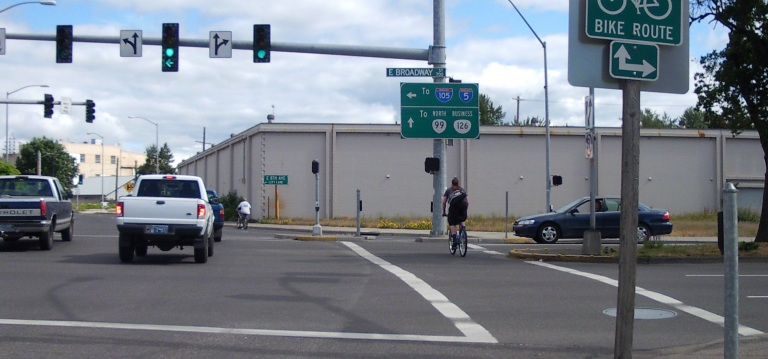 Cyclists navigating Broadway and Hilyard in Eugene