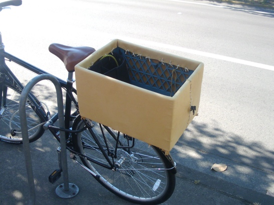 Bicycle with a milk crate covered in leather