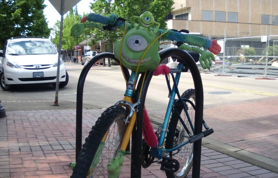 A bicycle decorated with character from the movie Monsters Inc.